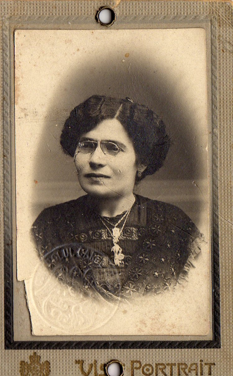 sepia photograph of a middle-aged woman with a turn-of-the century coiffe and pince-nez
